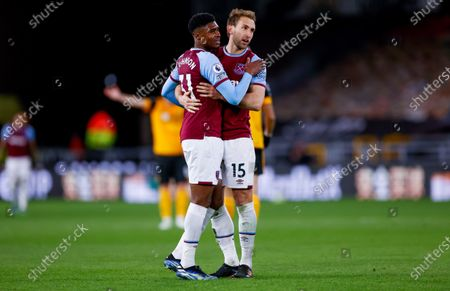 West Ham United defender Ben Johnson (31)  and West Ham United defender Craig Dawson (15) celebrate victory  during the Premier League match between Wolverhampton Wanderers and West Ham United at Molineux, Wolverhampton