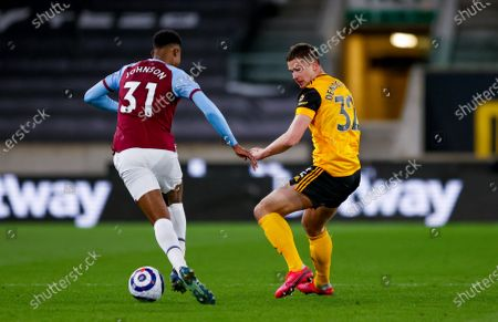 West Ham United defender Ben Johnson (31)  is challenged by Wolverhampton Wanderers midfielder Leander Dendoncker (32)  during the Premier League match between Wolverhampton Wanderers and West Ham United at Molineux, Wolverhampton