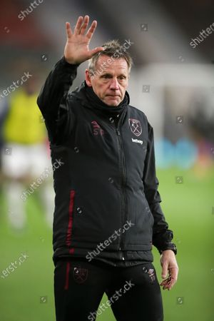 West Ham United assistant coach Stuart Pearce reacts during the warm up before the English Premier League soccer match between Wolverhampton Wanderers and West Ham United in Wolverhampton, Britain, 05 April 2021.