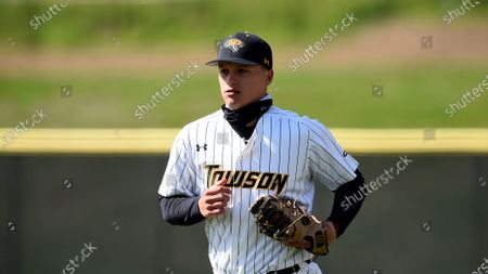 Towson infielder Nick Brown (14) runs off the field between innings against Delaware during an NCAA baseball game, in Towson, Md