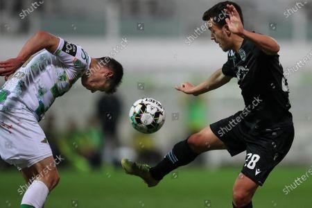 Moreirense's Filipe Soares (L) in action against Sporting's Pedro Gonçalves during their Portuguese First League soccer match, held at Comendador Joaquim de Almeida Freitas stadium, in Moreira de Conegos, north of Portugal, 05 April 2021.
