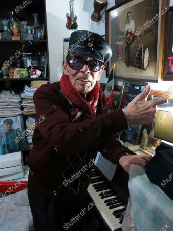 Mexican jazz player Tino Contreras poses in his studio in Mexico City. Contreras will present a streaming concert from the Casa Azul museum, the old house of Frida Kahlo, on April 10 and 11