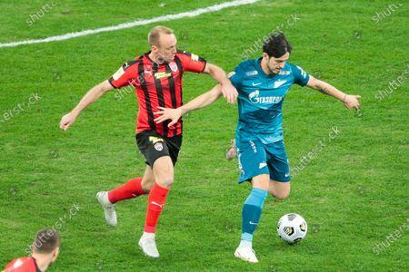 Stock Photo of Midfielder Denis Glushakov of FC Khimki and Forward Sardar Azmoun of FC Zenit during Russian Premier League match FC Zenit v FC Khimki at Zenit Arena