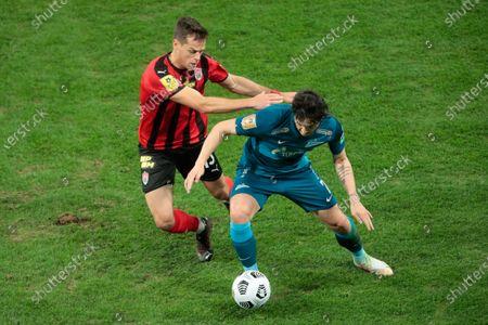 Defender Egor Danilkin of FC Khimki and Forward Sardar Azmoun of FC Zenit during the Russian Premier League match FC Zenit v FC Khimki at Zenit Arena