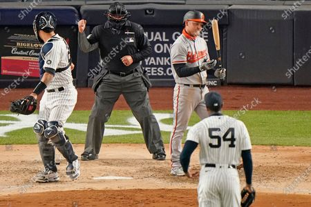 Baltimore Orioles Pat Valaika (11) reacts after striking out for the final out of a 7-0 shoutout loss to the New York Yankees in a baseball game, at Yankee Stadium in New York. Home plate umpire Sam Holbrook calls the strike as Yankees catcher Gary Sanchez, left, checks the call with Yankees relief pitcher Aroldis Chapman (54) on the mound
