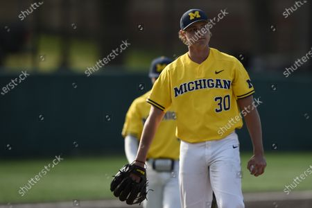 Michigan pitcher Jack White reacts after giving up a home run during an NCAA baseball game on Monday 5, 2021, in College Park, Md