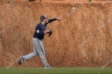 Milwaukee Brewers starting pitcher Brett Anderson (25) warms up in the outfield before a baseball game, against the Chicago Cubs, in Chicago