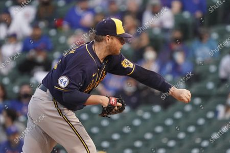 Milwaukee Brewers starting pitcher Brett Anderson (25) throws against the Chicago Cubs during the first inning of a baseball game, in Chicago