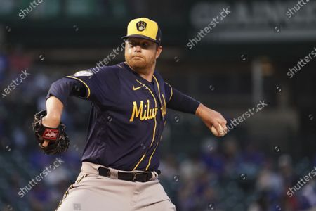 Milwaukee Brewers starting pitcher Brett Anderson (25) throws the ball against the Chicago Cubs during the third inning of a baseball game, in Chicago