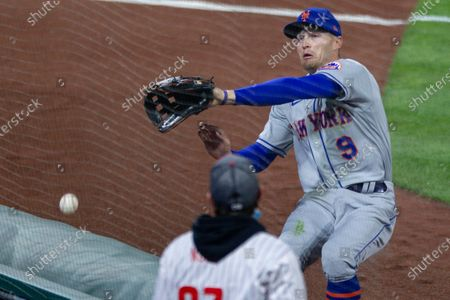 Stock Photo of New York Mets center fielder Brandon Nimmo (9) tries to catch a foul ball during the third inning of a baseball game, in Philadelphia