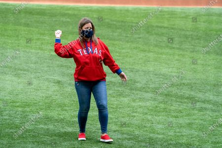 Stock Picture of Audrey Simmons, a schoolteacher from Arlington, Texas, throws out the ceremonial first pitch before a baseball game between the Texas Rangers and the Toronto Blue Jays, in Arlington, Texas. Simmons was selected to throw out the first pitch after Texas Gov. Greg Abbott declined to throw out the first pitch in protest of Major League Baseball's decision to move its All-Star Game out of Georgia because of Georgia's controversial voter registration legislation