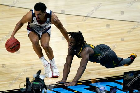 Gonzaga guard Jalen Suggs, left, fights for a loose ball with Baylor guard Davion Mitchell, right, during the first half of the championship game in the men's Final Four NCAA college basketball tournament, at Lucas Oil Stadium in Indianapolis