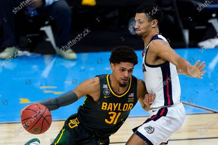 Baylor guard MaCio Teague (31) drives around Gonzaga guard Jalen Suggs, right, during the second half of the championship game in the men's Final Four NCAA college basketball tournament, at Lucas Oil Stadium in Indianapolis