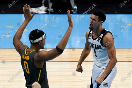 Gonzaga guard Jalen Suggs (1) celebrates in front of Baylor forward Flo Thamba (0) after making a basket during the second half of the championship game in the men's Final Four NCAA college basketball tournament, at Lucas Oil Stadium in Indianapolis