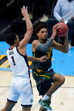 Baylor guard MaCio Teague (31) drives to the basket ahead over Gonzaga guard Jalen Suggs (1) during the second half of the championship game in the men's Final Four NCAA college basketball tournament, at Lucas Oil Stadium in Indianapolis