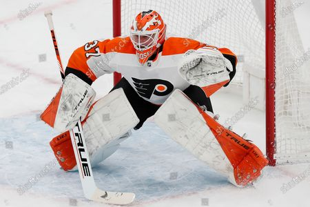 Philadelphia Flyers' Brian Elliott plays against the Boston Bruins during the first period of an NHL hockey game, in Boston