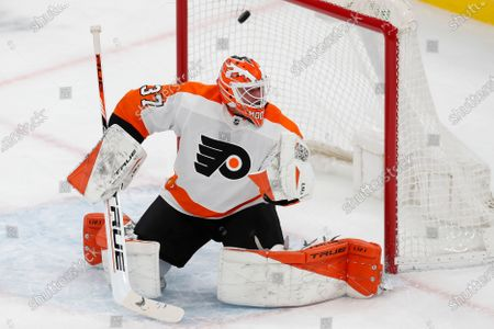 The shot by Boston Bruins' Karson Kuhlman gets past Philadelphia Flyers' Brian Elliott (37) during the first period of an NHL hockey game, in Boston