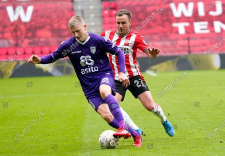 Stock Picture of Mats Knoester (Heracles) (L) and Mario Gotze (PSV)during Eredivisie football PSV-Heracles Almelo in Eindhoven, Netherlands