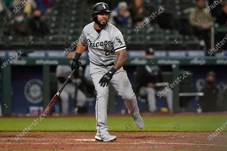 Chicago White Sox's Leury Garcia reacts to a strike during an at-bat in the seventh inning of a baseball game against the Seattle Mariners, in Seattle. Garcia struck out on the play