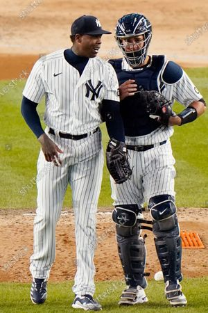 Stock Picture of New York Yankees relief pitcher Aroldis Chapman (54) talks to New York Yankees catcher Gary Sanchez (24) after the yankees shutout the Baltimore Orioles 7-0 in a baseball game, at Yankee Stadium in New York