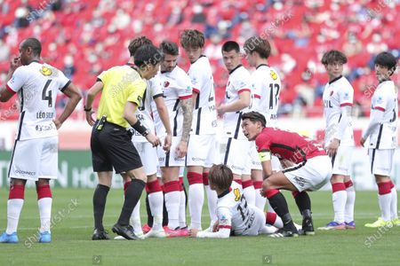 (L to R)  Yusuke Araki (referee), Ryotaro Araki (Antlers), Tomoaki Makino (Reds) - Football / Soccer : 2021 J1 League match between Urawa Red Diamonds 2-1 Kashima Antlers at Saitama Stadium 2002, Saitama, Japan.