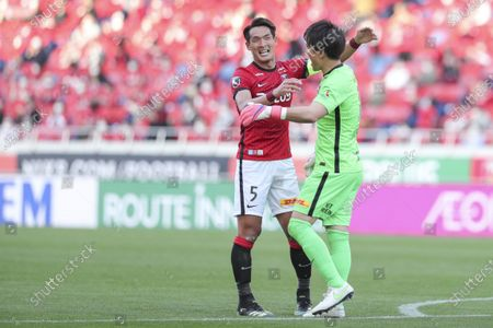 Stock Photo of (L to R) Tomoaki Makino, Shusaku Nishikawa (Reds) - Football / Soccer : 2021 J1 League match between Urawa Red Diamonds 2-1 Kashima Antlers at Saitama Stadium 2002, Saitama, Japan.