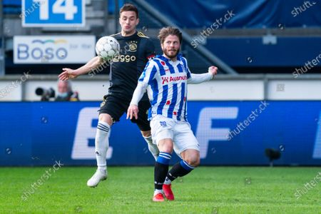 Stock Picture of Lasse Schone (SC Heerenveen) duels Dusan Tadic of Ajax during Eredivisie match SC Heerenveen-Ajax on April, 4 2021 in Heerenveen Netherlands