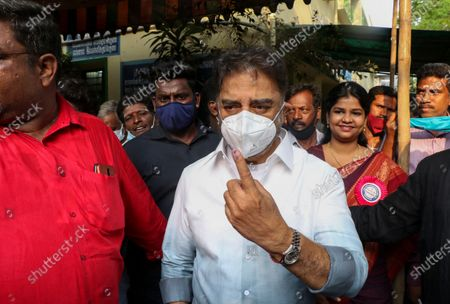 Stock Photo of Makkal Needhi Maiam party leader and film actor Kamal Haasan displays his ink mark after casting his vote in the Tamil Nadu state assembly elections in Chennai, India
