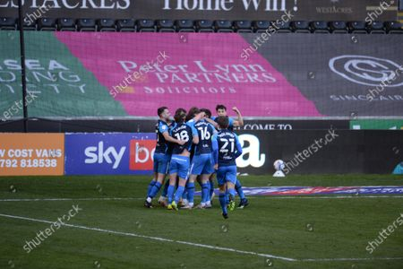 Scott Sinclair of Preston North End celebrates with teammates after Matt Grimes of Swansea City scored an own goal during the Sky Bet Championship match between Swansea City and Preston North End at the Liberty Stadium, Swansea on Monday 5th April 2021.