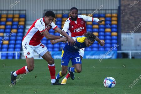 James Hill of Fleetwood Town and Ayoub Assal of AFC Wimbledon battle for the ball during the Sky Bet League 1 match between AFC Wimbledon and Fleetwood Town at Plough Lane, Wimbledon, London, UK on 5th April 2021.