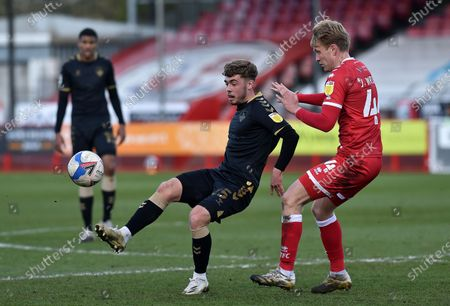 Oldham Athletic's Alfie McCalmont tussles with Josh Wright of Crawley Town  during the Sky Bet League 2 match between Crawley Town and Oldham Athletic at Broadfield Stadium, Crawley, England on 5th April 2021.