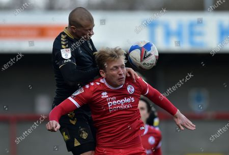 Oldham Athletic's Harry Clarke tussles with Josh Wright of Crawley Town during the Sky Bet League 2 match between Crawley Town and Oldham Athletic at Broadfield Stadium, Crawley, England on 5th April 2021.