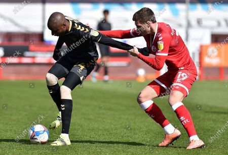 Oldham Athletic's Dylan Bahamboula tussles with Jordan Tunnicliffe of Crawley Town during the Sky Bet League 2 match between Crawley Town and Oldham Athletic at Broadfield Stadium, Crawley, England on 5th April 2021.