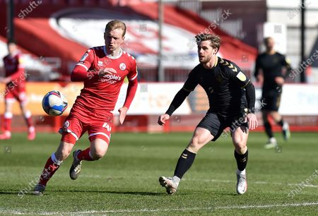 Oldham Athletic's Conor McAleny tussles with Josh Wright of Crawley Town during the Sky Bet League 2 match between Crawley Town and Oldham Athletic at Broadfield Stadium, Crawley, England on 5th April 2021.