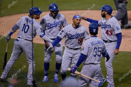 Stock Picture of Los Angeles Dodgers' Chris Taylor, second from left, Mookie Betts, center, and Edwin Rios (43) are congratulated by Justin Turner (10) and Cody Bellinger (35) after scoring against the Oakland Athletics during the second inning of a baseball game in Oakland, Calif
