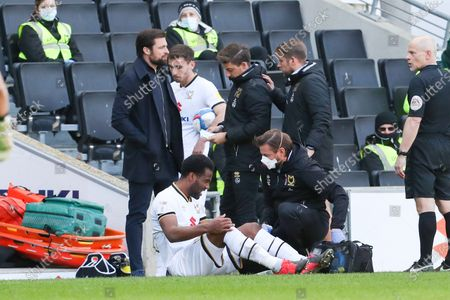 Milton Keynes Dons Cameron Jerome receives some attention before being substituted during the second half of the Sky Bet League One match between MK Dons and Crewe Alexandra at Stadium MK, Milton Keynes, England on 5th April 2021.
