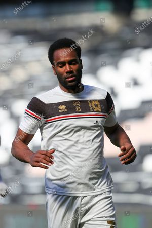 Milton Keynes Dons Cameron Jerome warms up before the Sky Bet League One match between MK Dons and Crewe Alexandra at Stadium MK, Milton Keynes, England on 5th April 2021.