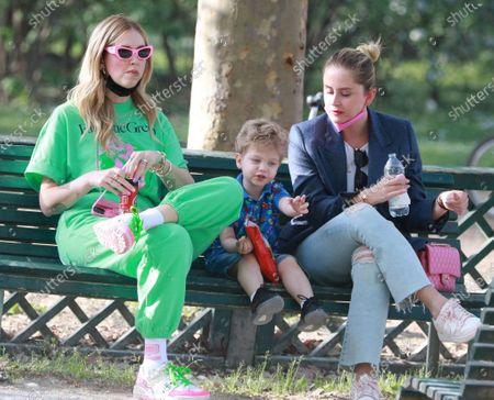 Chiara Ferragni with her sister Valentina Ferragni and son Leone Lucia Ferragni at Parco Sempione