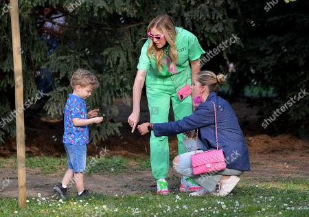 Stock Image of Chiara Ferragni with her son Leone Lucia Ferragni and her sister Valentina Ferragni in the park