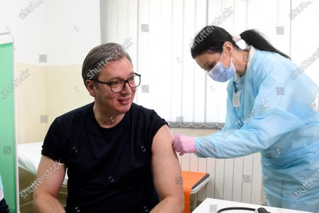 In this photo provided by the Serbian Presidential Press Service, Serbian President Aleksandar Vucic receives a dose of the Chinese Sinopharm vaccine in the village of Rudna Glava, Serbia, . Vucic finally rolled up his sleeve for a coronavirus vaccine Tuesday and to encourage his country's increasingly skeptical Serbs to get vaccinated themselves