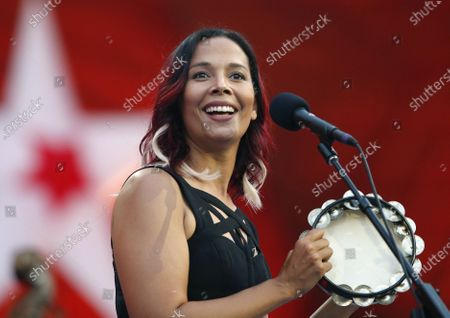 "Rhiannon Giddens performs during rehearsal for the Boston Pops Fireworks Spectacular in Boston. Giddens' new album, ""They're Calling Me Home,"" releases on Friday"