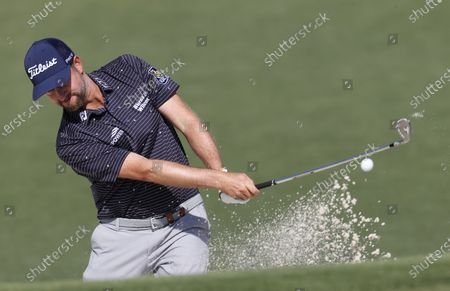 Webb Simpson chips from the bunker on the second fairway during a practice round for the 2021 Masters Tournament at the Augusta National Golf Club in Augusta, Georgia, USA, 06 April 2021. The 2021 Masters Tournament is held 08 April through 11 April 2021.