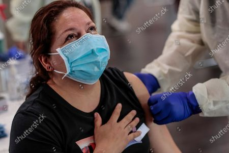 Bell, CA, Monday, April 5, 2021 - Grisela Rocha, 43, sighs in relief seconds after receiving a Covid-19 vaccination at the Bell Community Center. (Robert Gauthier/Los Angeles Times)
