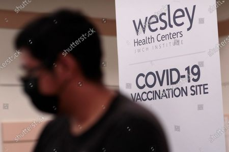 Bell, CA, Monday, April 5, 2021 - Covid-19 vaccinations are offered at the Bell Community Center the day it is announced that 4 million shots have been provided to underserved communities. (Robert Gauthier/Los Angeles Times)