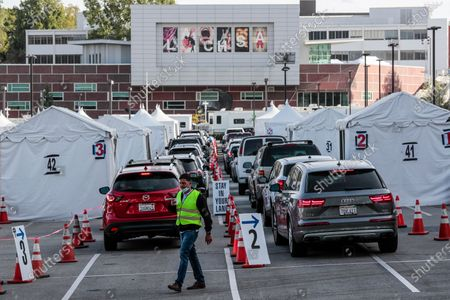 Stock Photo of Los Angeles CA, Monday, April 5, 2021 - Drivers line up for Covid-19 vaccines at Cal State LA the day it is announced that 4 million shots have been provided to under served communities. (Robert Gauthier/Los Angeles Times)