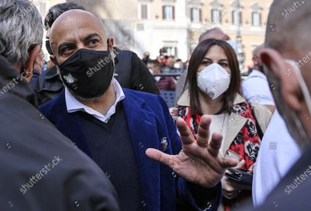 Italian deputy Gianluigi Paragone (C-L) among protesters during the demonstration of traders, shopkeepers and restaurateurs next to the Chamber of Deputies in piazza Montecitorio against anti-Covid-19 closures, in Rome, Italy, 06 April 2021.