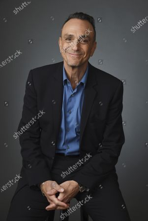 """Actor Hank Azaria poses for a portrait during the 2020 Winter Television Critics Association Press Tour in Pasadena, Calif on . Azaria will host a half-hour podcast, """"The Jim Brockmire Podcast,"""" featuring guests across sports and entertainment. The first guest is Charles Barkley on Wednesday's debut. Azaria portrayed the foul-mouthed baseball announcer on the IFC channel comedy """"Brockmire"""