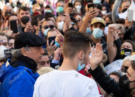Stock Photo of Italian actor Enrico Montesano (L) speaks during the demonstration of traders, shopkeepers and restaurateurs as they protest over lockdown measures to curb the spread of Covid-19, next to the Chamber of Deputies in piazza Montecitorio, in Rome, Italy, 06 April 2021.