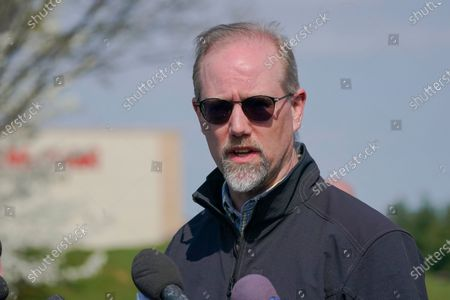 Frederick Mayor Michael O'Connor speaks during a news conference near the scene of a shooting at a business park in Frederick, Md