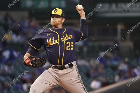 Stock Image of Milwaukee Brewers starting pitcher Brett Anderson (25) throws the ball against the Chicago Cubs during the third inning of a baseball game, in Chicago